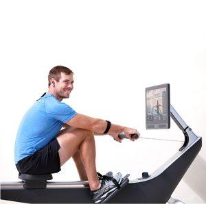 man using hydrow rower